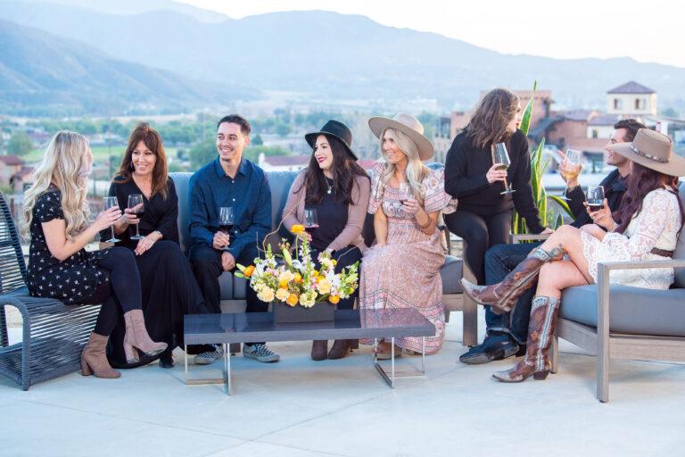 wine club members enjoying altisima patio and talking