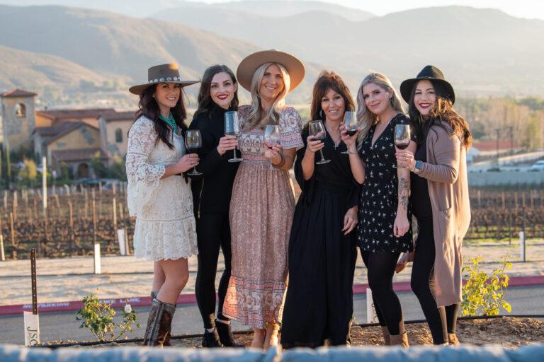 ladies toasting in front of altisima