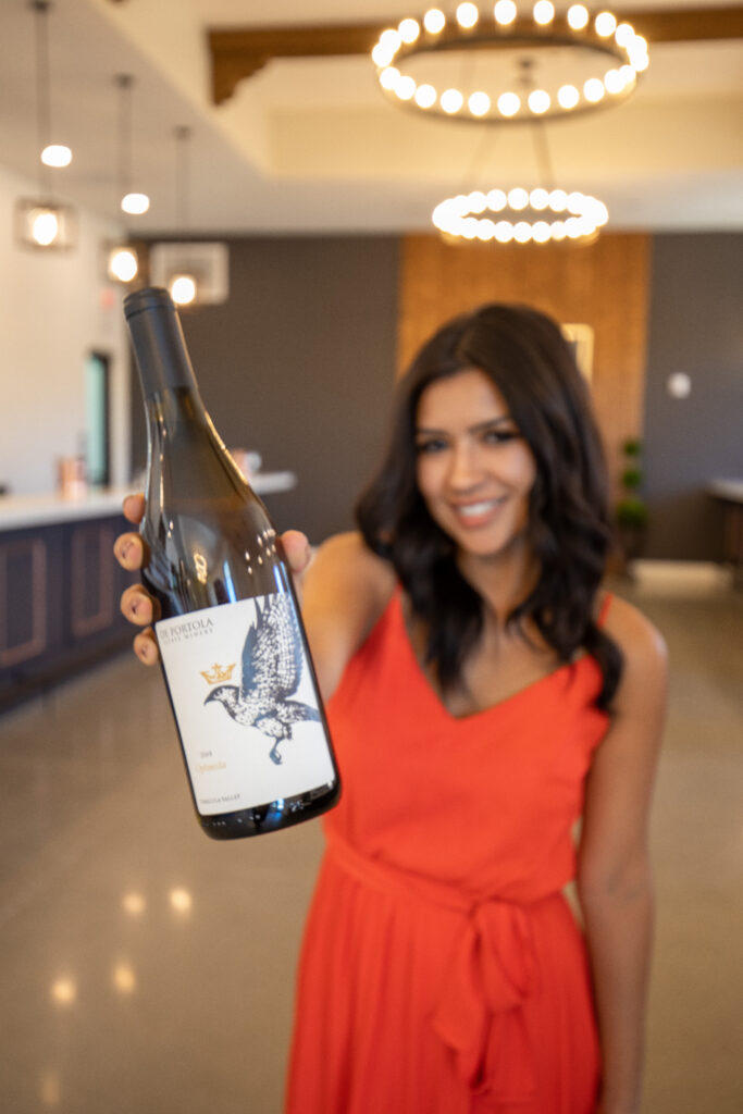 woman holding wine